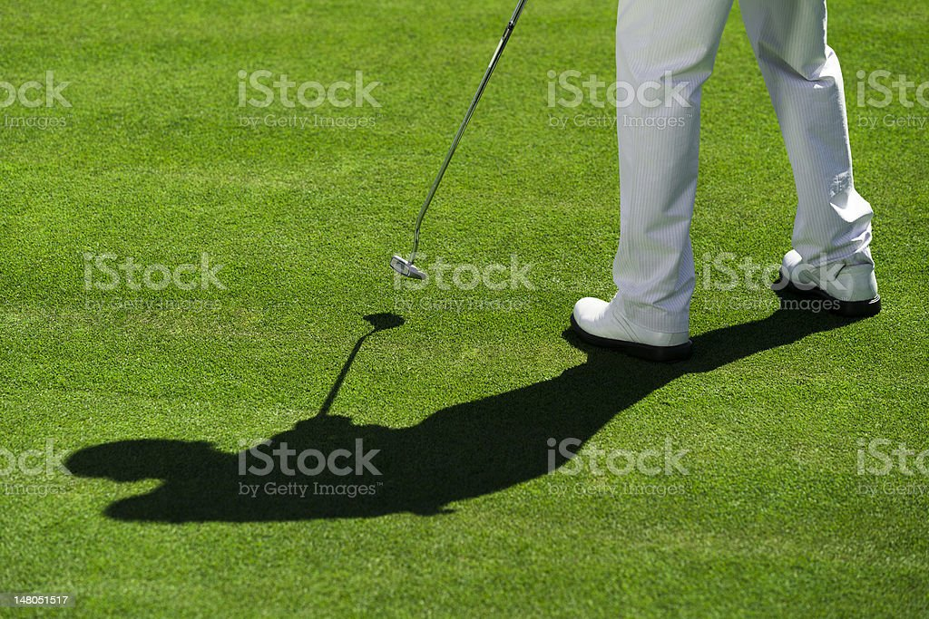 golfer and shadow on the glass royalty-free stock photo