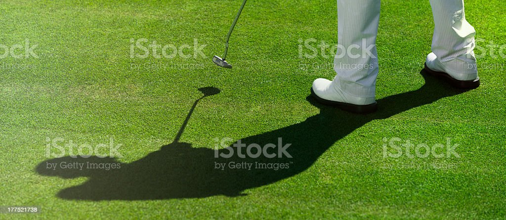golfer and shadow royalty-free stock photo