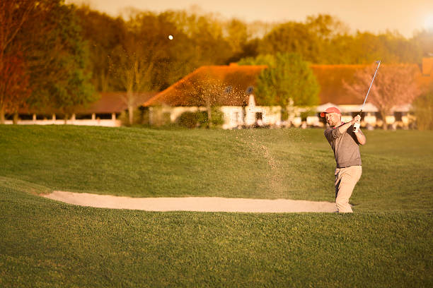 Golfer at bunker. stock photo