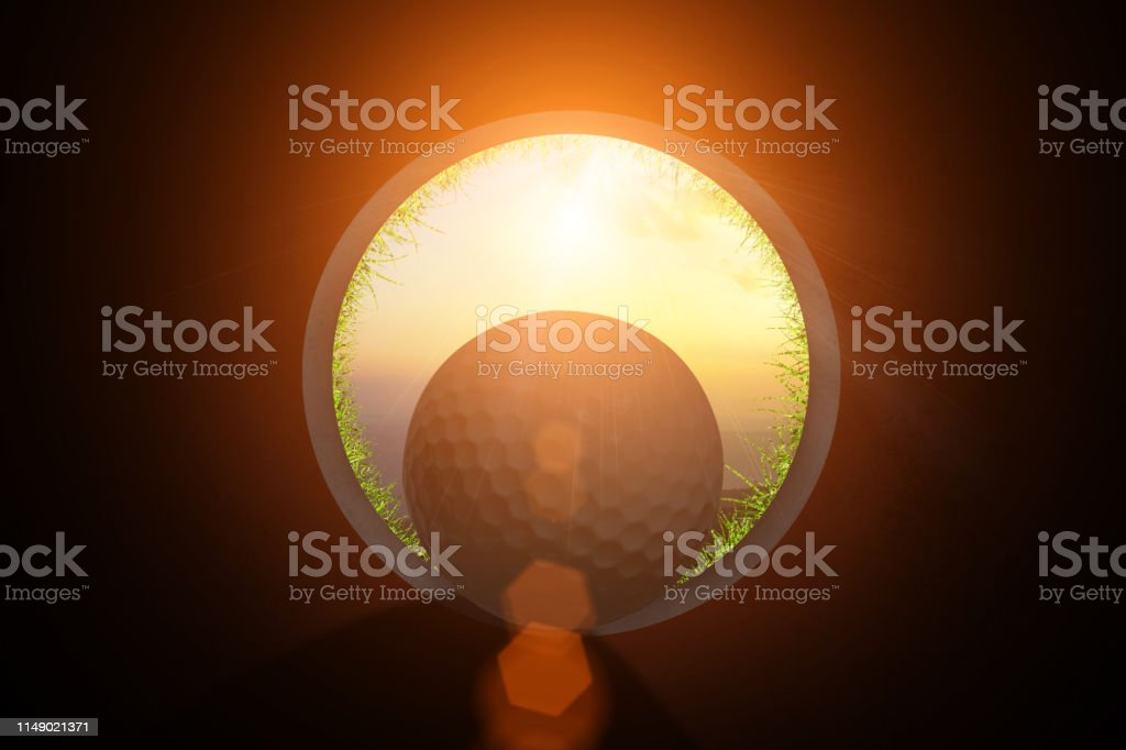 Golfer at golf ball view from inside the hole of cup in the green...