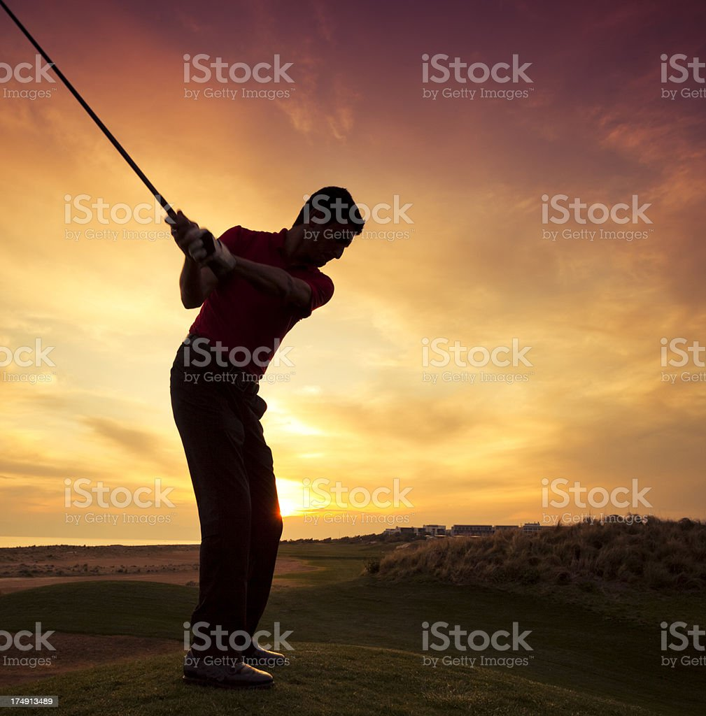 Golfer at sunset royalty-free stock photo
