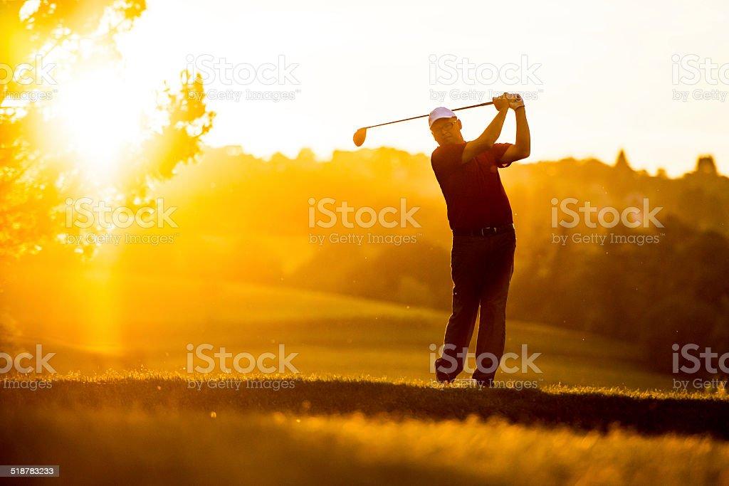 Golfer at Sunset stock photo
