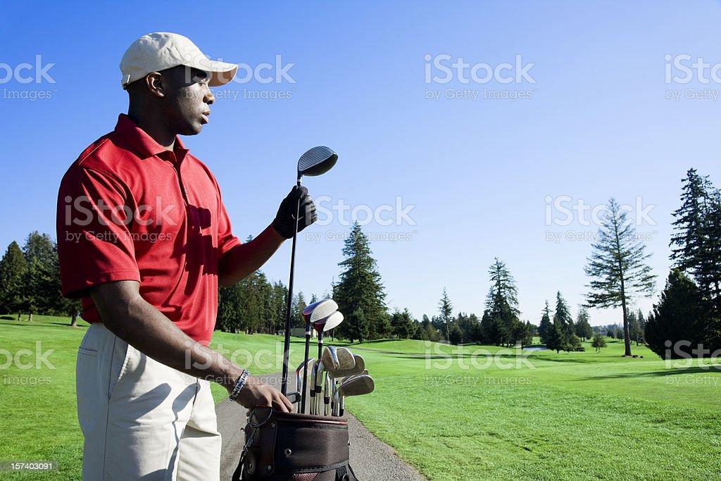 Golfer Choosing Club stock photo