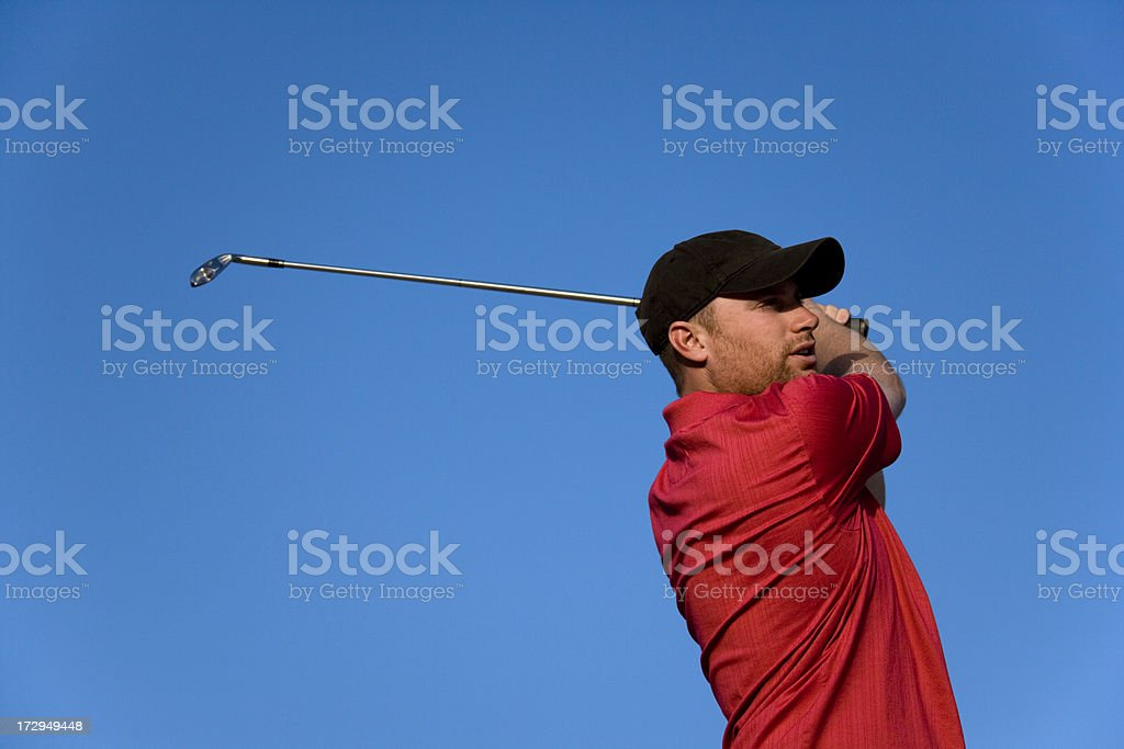 Golfer Concentration - Finishing Swing royalty-free stock photo