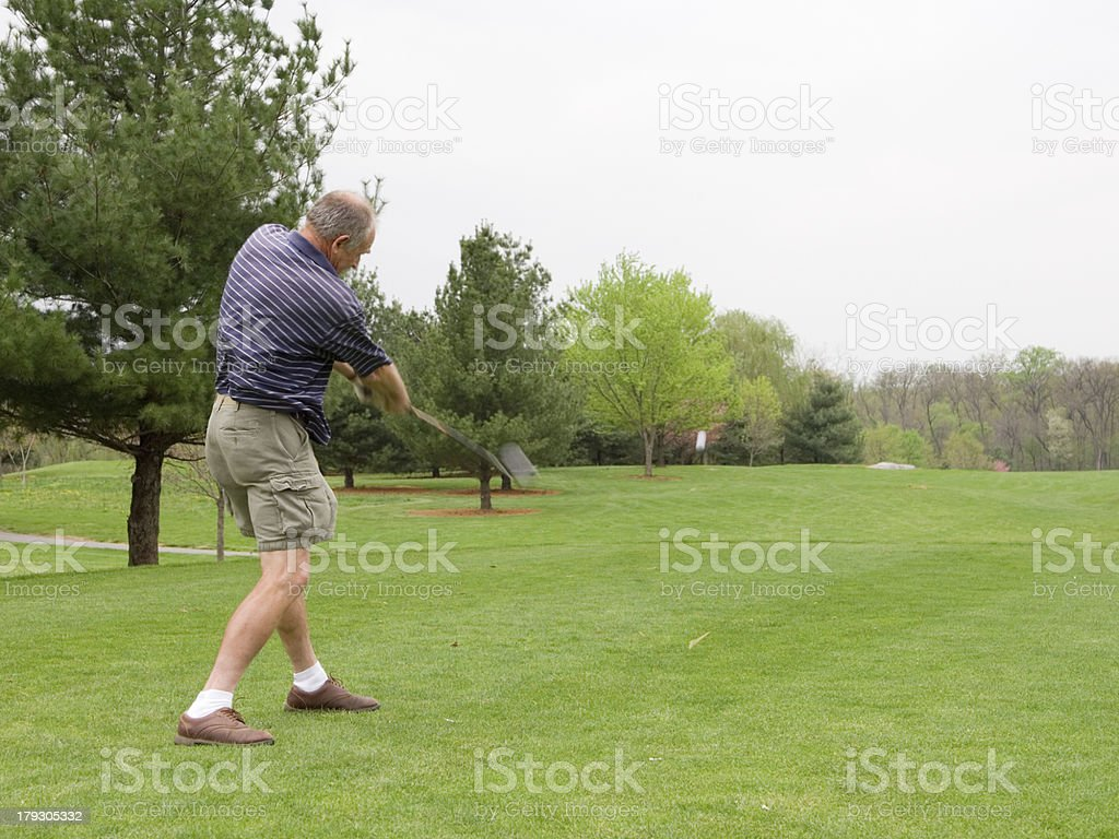\'Golfer crushing a golf ball off the tee. This scene is FILLED with...