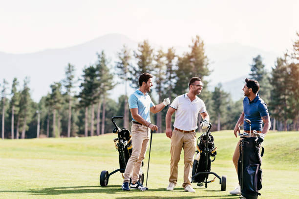 Golfer friends stock photo