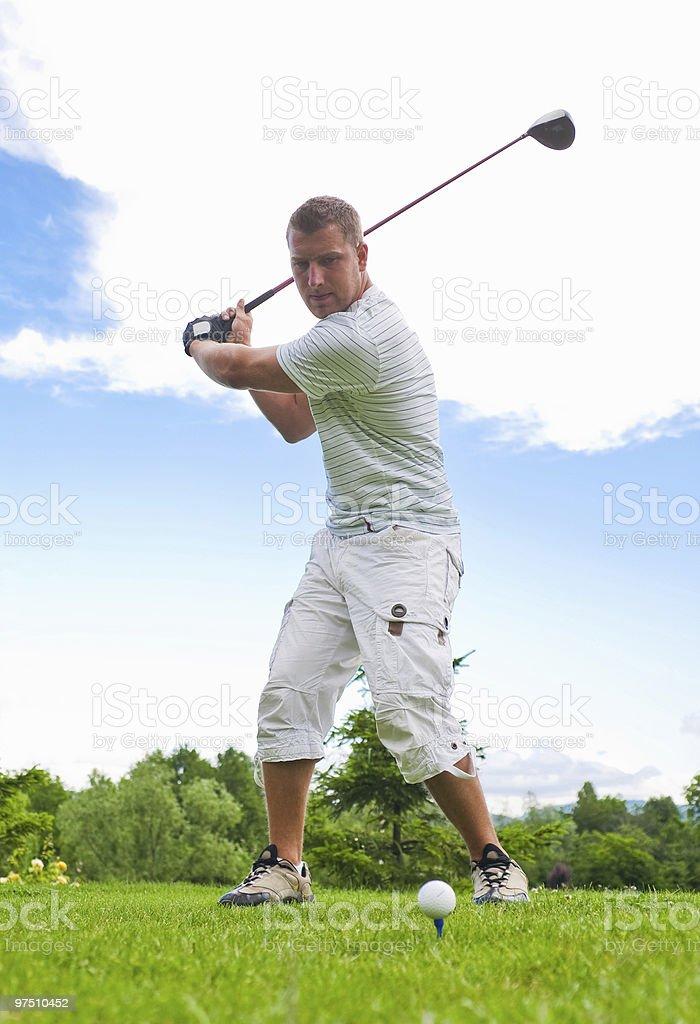 Golfer hitting ball royalty-free stock photo
