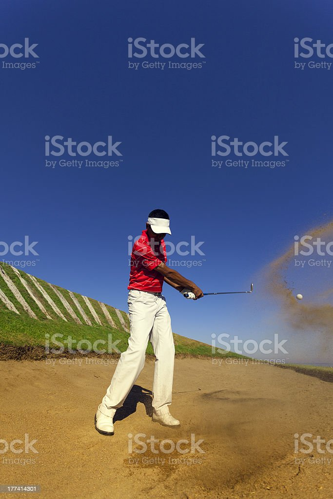 golfer hitting on sand bunker royalty-free stock photo