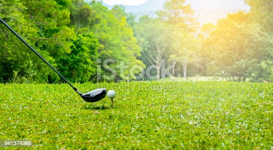 istock Golfer hitting on tee off zone in beautiful golf course 941374966