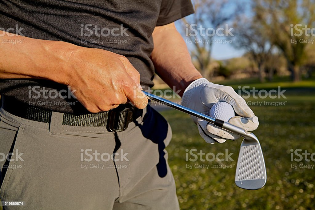 Golfer holding a Club and Ball stock photo