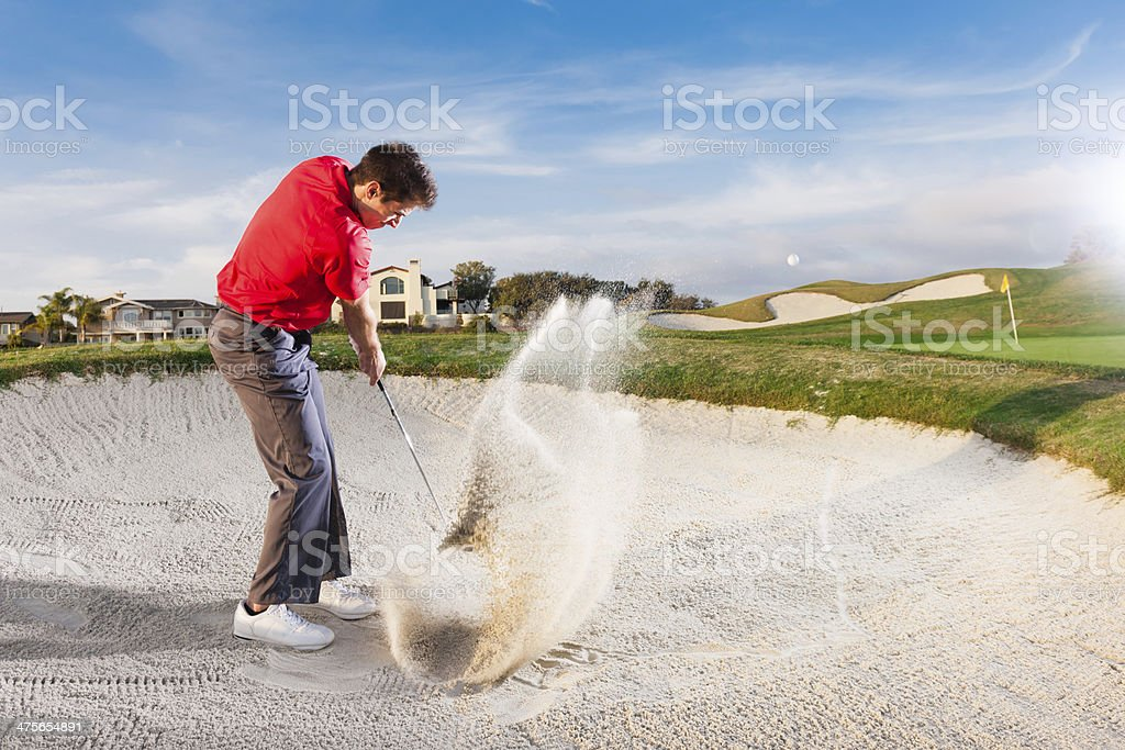 Golfer in a Sand Bunker stock photo