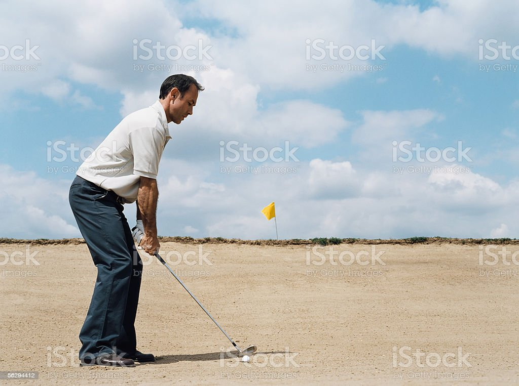 Golfer in a sand trap royalty-free stock photo