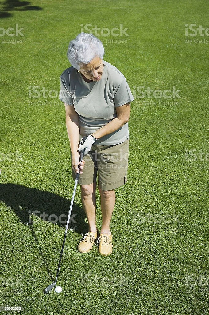 Golfer in action royalty-free stock photo