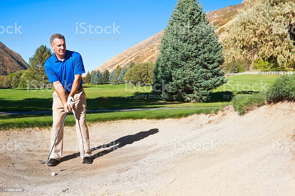 Golfer in the Bunker royalty-free stock photo