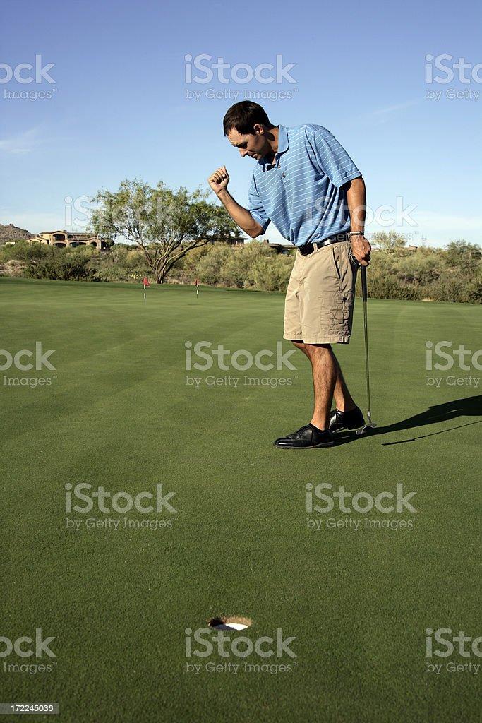 Golfer Making Putt royalty-free stock photo