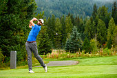 Golfer making the drive. Golf in Canada. Male athlete playing golf.