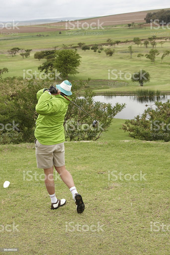 Golfer on follow-through royalty-free stock photo
