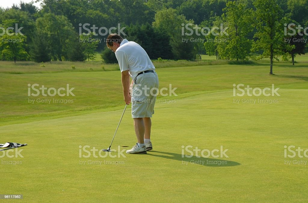 golfer on putting green royalty-free stock photo