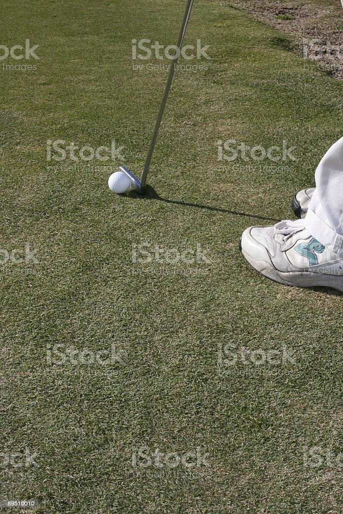 Golfer on the green royalty-free stock photo