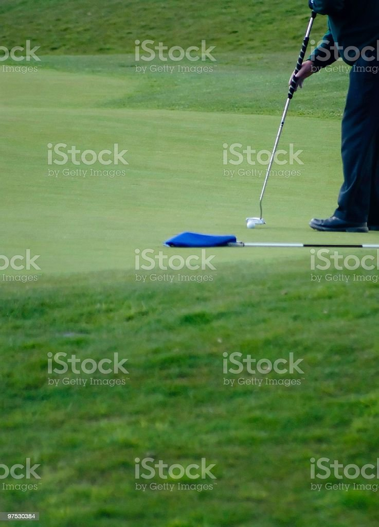 Golfer on the green putting. royalty-free stock photo
