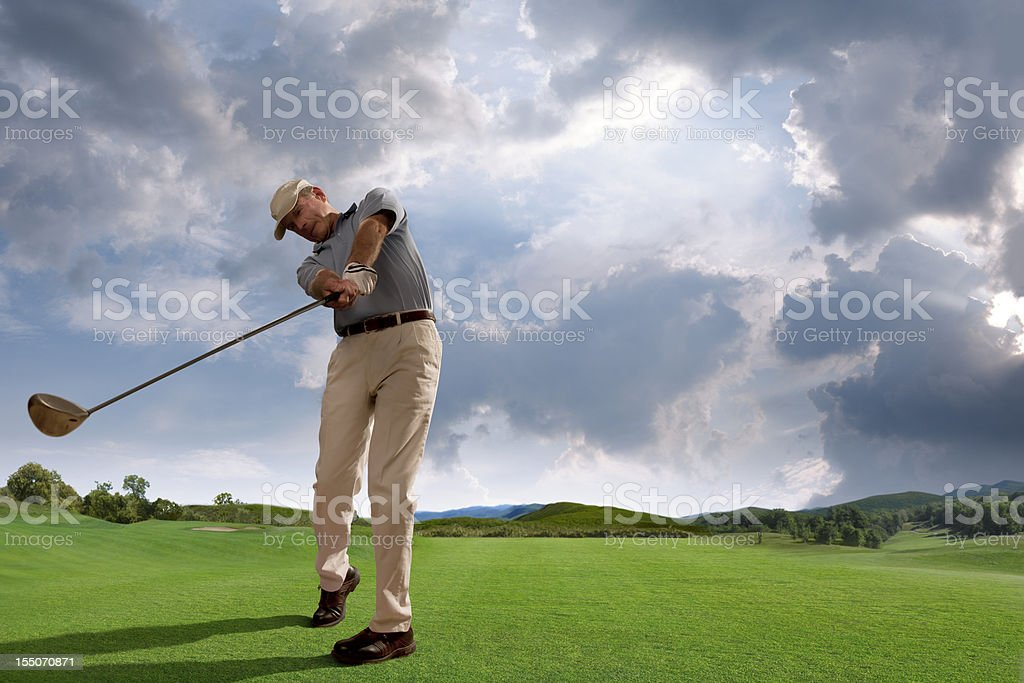 Golfer Playing on Golf Course stock photo