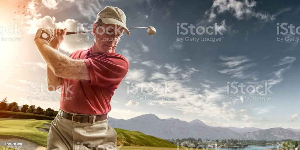 Golfer Portrait in Mid Backswing stock photo