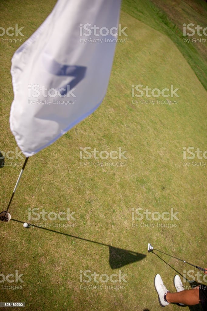 Golfer Putting Ball on the Green stock photo