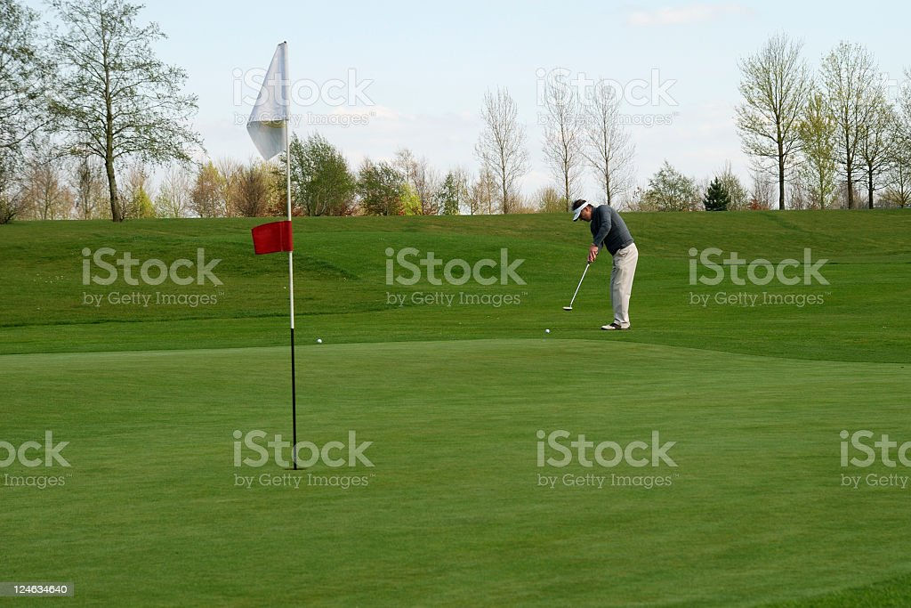 Golfer putting from off the green