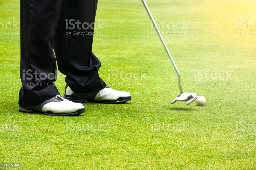 Golfer putting golf ball to hole for the winner of tournament stock photo