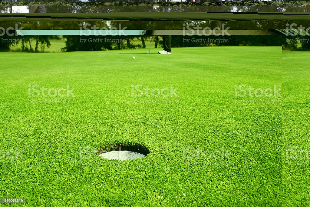 A golfer, putting on green. Distance to the hole: approx. 7-8 m.