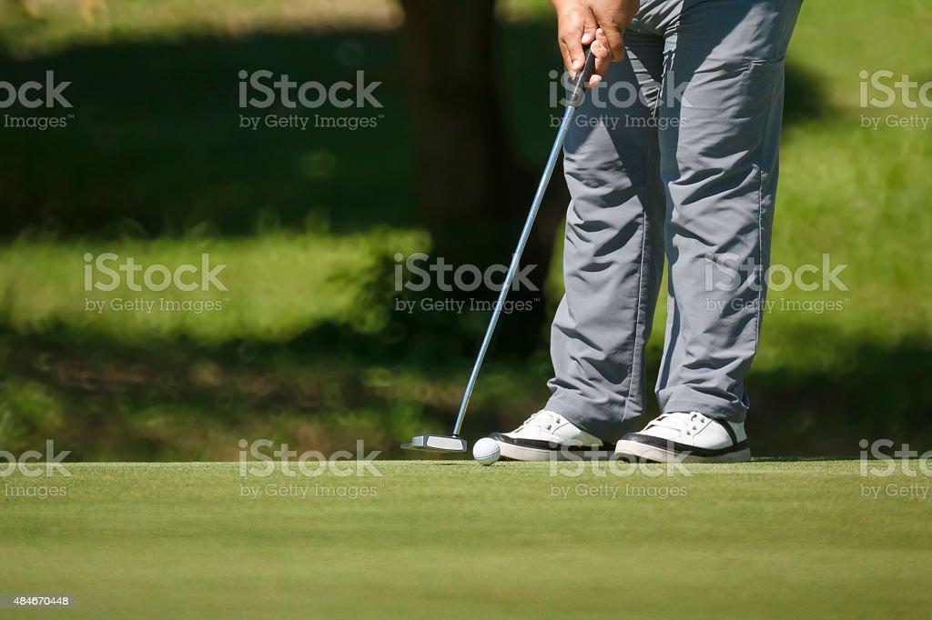 Golfer putting on green. stock photo