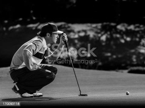 A man takes aim for his putt.http://blog.michaelsvoboda.com/GolfBanner.jpg