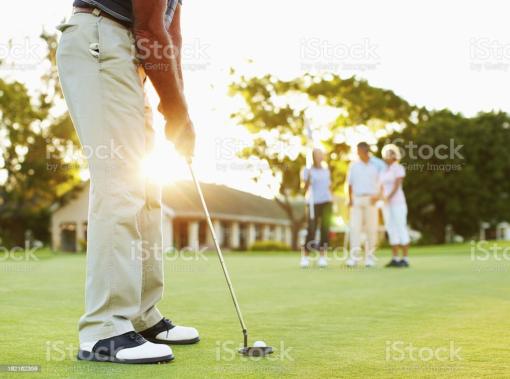 Golfer ready to putt stock photo