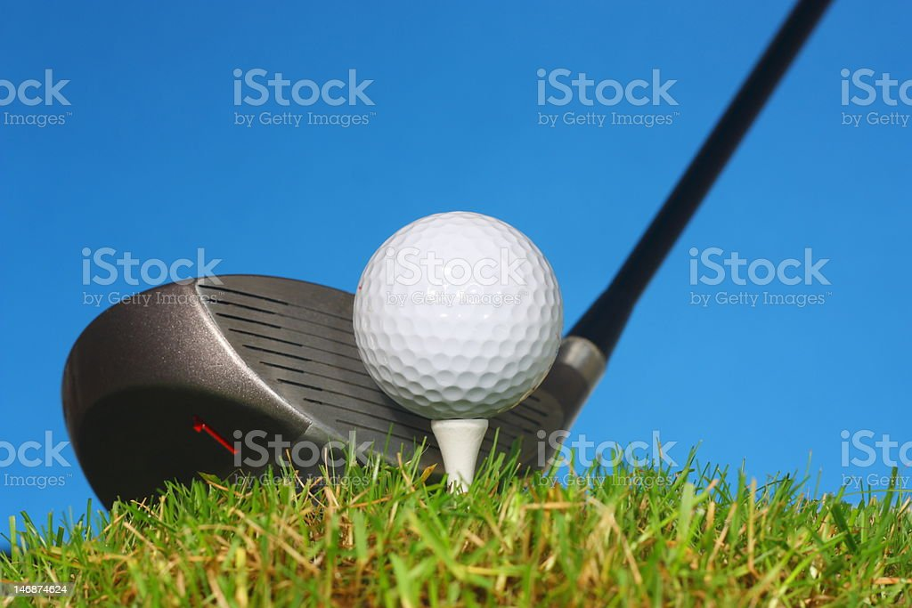 Golfer ready to tee off with a driver. stock photo