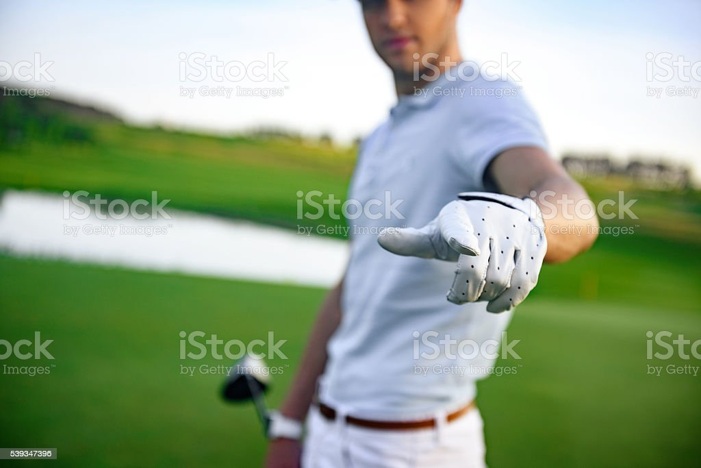 Golfer standing on golf course stock photo