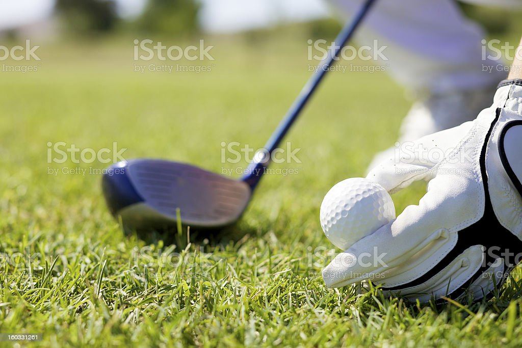 Golfer stepping up to his ball.