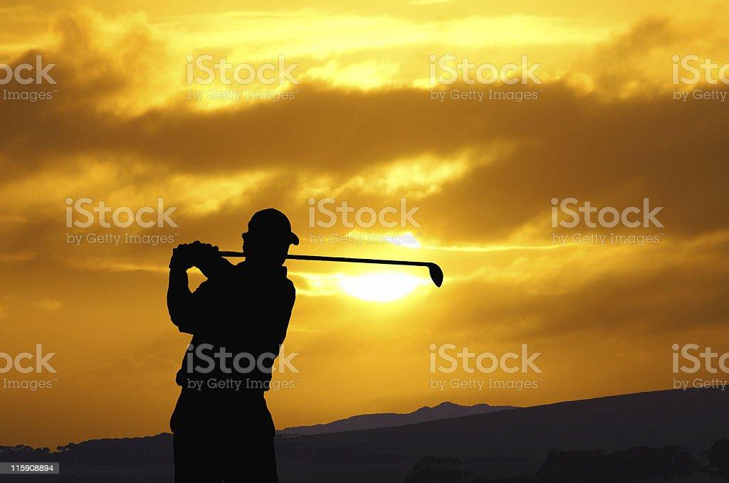 golfer swing sunset stock photo