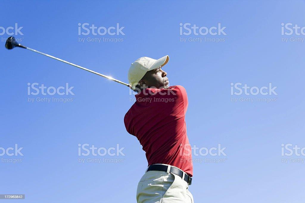 Golfer Swinging Club stock photo