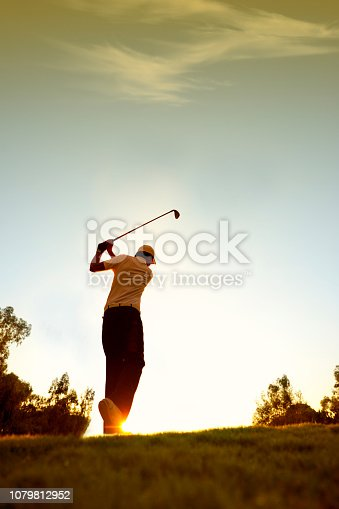 Golfer swinging. sRGB.