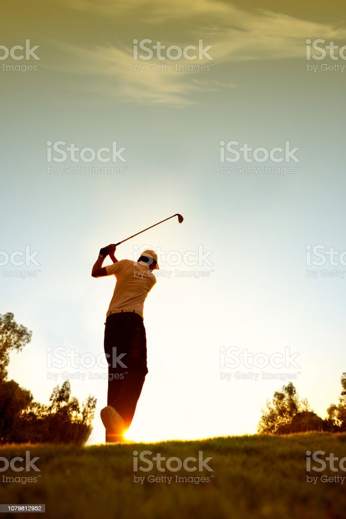 Golfer swinging. sRGB. stock photo