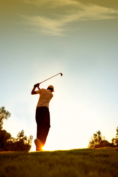Golfer swinging. sRGB. stock photo