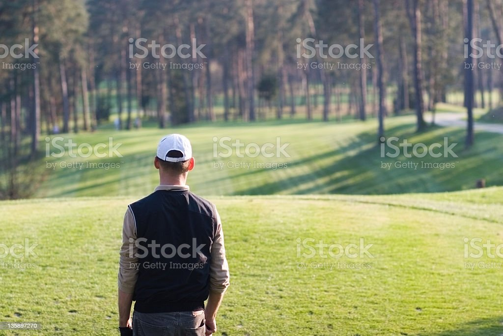 Golfer waiting to tee off royalty-free stock photo