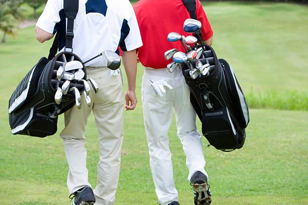 Golfer walking stock photo