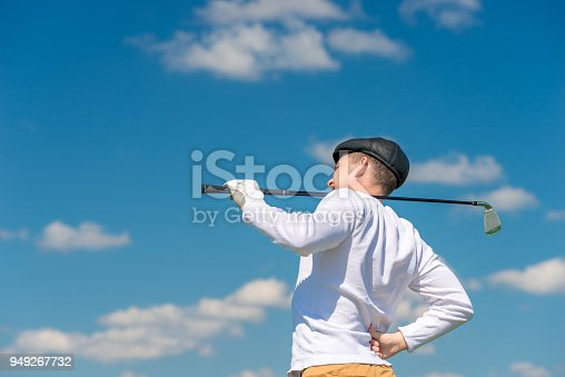 istock Golfer with a golf club rubs a sick back on the field 949267732