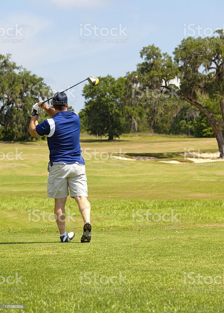 Golfer with a Good Tee  Shot royalty-free stock photo