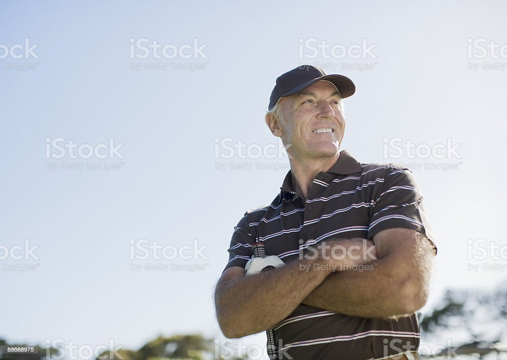 Golfer with arms crossed royalty-free stock photo