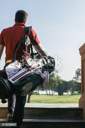 Golfer with his bag entering in a golf course