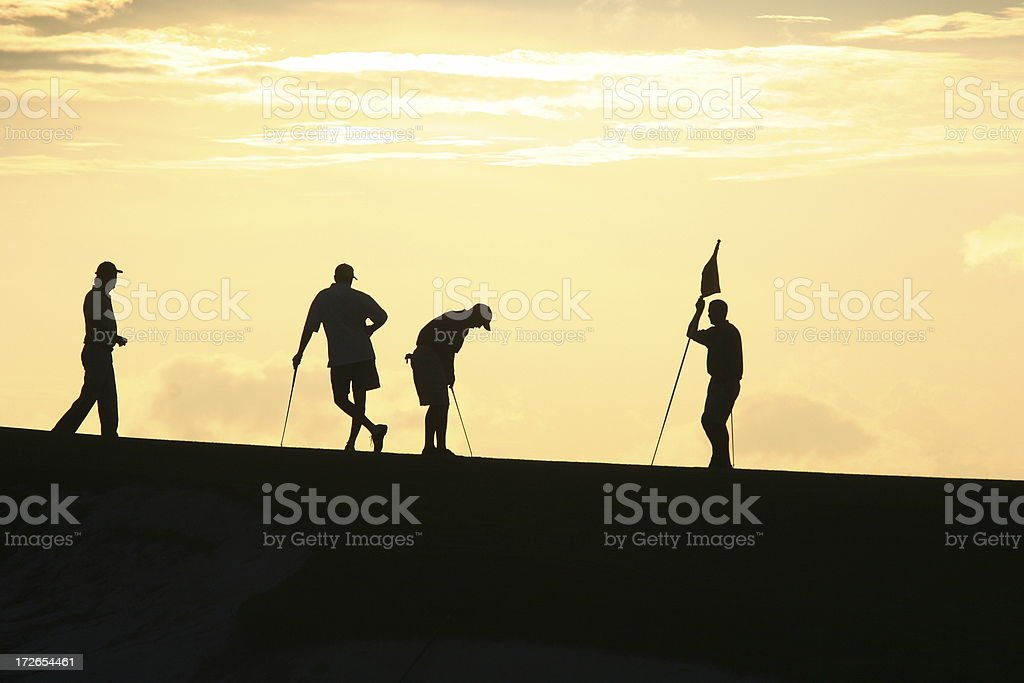 Golfers at Sunset 2 royalty-free stock photo