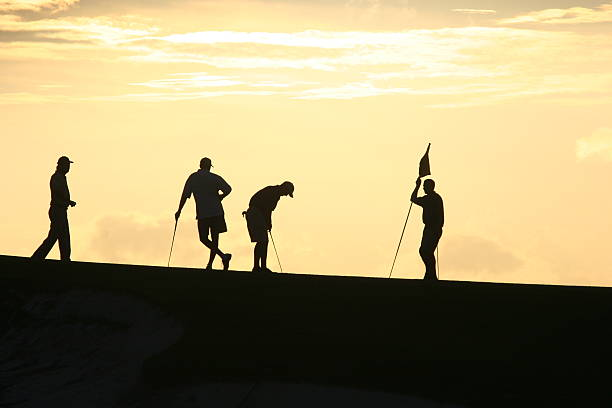 Golfers at Sunset 2 stock photo