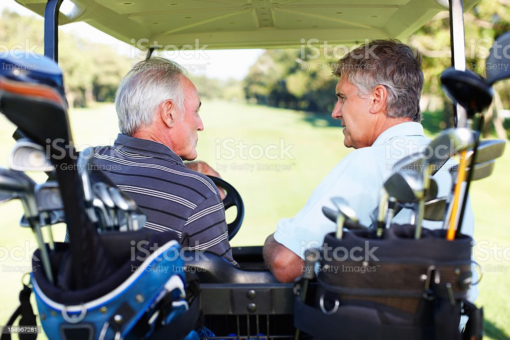 Golfers discussing stock photo